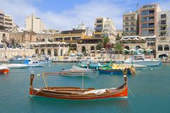 Traditional Boat in St.Julians, Malta. Traditional Maltese Boat in a popular and quaint harbour village in Malta Stock Images