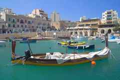 Traditional Boat in St.Julians, Malta. Traditional Maltese Boat in a popular and quaint harbour village in Malta Royalty Free Stock Images
