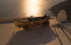 Traditional boat at sunset in Santorini island Stock Image