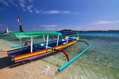 Traditional boat on tropical beach Stock Photography