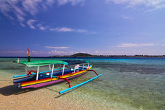 Traditional boat on tropical beach Stock Images