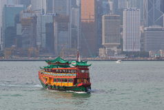 Traditional Boat on Victoria Harbour. Hong Kong. Royalty Free Stock Photo