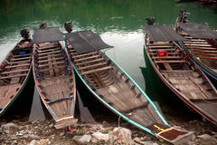 Traditional boat waiting tourists in Cheow Larn lake,Thailand. Stock Images