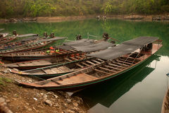 Traditional boat waiting tourists in Cheow Larn lake,Thailand. Stock Photo