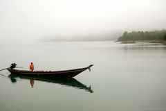 Traditional boat waiting tourists in Cheow Larn lake,Thailand. Stock Photos