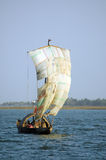 Traditional boat in West Africa with a sail stock images