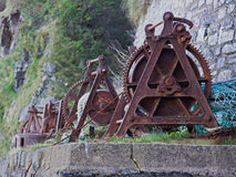 Traditional Boat Winches. A line of rusted winches for hauling boats ashore on the North Devon coast UK Royalty Free Stock Photography