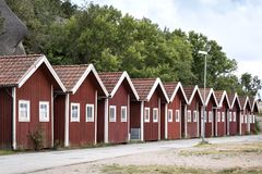 Traditional boathouses are located in a small harbor, Sweden. Close to the Swedish skerry archipelago in the province of Bohuslan, these traditional boathouses stock photos