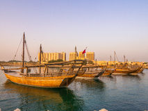 Traditional boats called Dhows are anchored in the port Royalty Free Stock Photo