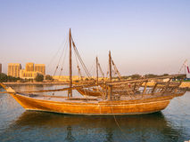 Traditional boats called Dhows are anchored in the port. Near Museum of Islamic Art Park in Doha, Qatar royalty free stock images