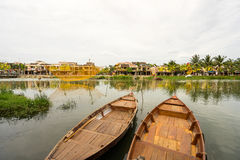 Traditional boats in front of ancient architecture in Hoi An. Vietnam. Hoi An is the World's Cultural heritage site, famous for mixed cultures & architecture Royalty Free Stock Photography