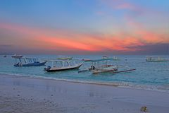 Traditional boats on Gili Meno beach in Indonesia, Asia. At sunset Royalty Free Stock Photography