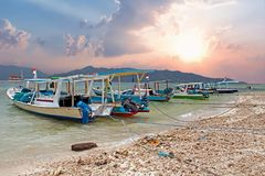Traditional boats on Gili Meno beach in Indonesia. Asia Royalty Free Stock Photo