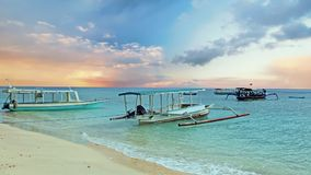 Traditional boats on Gili Meno beach in Indonesia, Asia. At sunrise Stock Photo