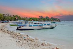 Traditional boats on Gili Meno beach in Indonesia, Asia. At sunset Stock Images