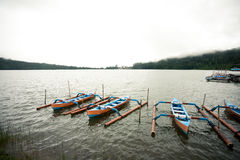 Traditional boats on lake Bratan Stock Images