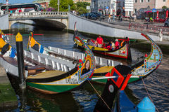 Traditional boats moliceiro on main city canal. Royalty Free Stock Images