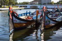 Traditional boats moliceiro on main city canal. Royalty Free Stock Image