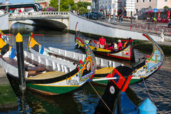 Traditional boats moliceiro on main city canal. Stock Photography