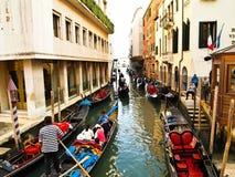 Traditional boats at narrow streets , Venice Italy. Venice - September 25: Port of Gondoliero sailing in Venice, September 25, 2010, Venice, Italy.  Traditional Royalty Free Stock Photo