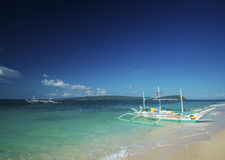 Traditional boats on puka beach in boracay philippines Stock Images