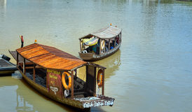Traditional boats on Sarawak river in Kuching city Stock Photo