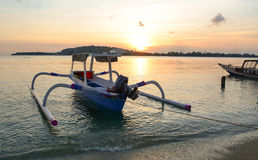 Traditional boats at sunset in Bali, Indonesia Stock Photo