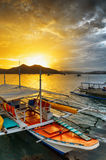 Traditional boats at sunset. Philippines Royalty Free Stock Images