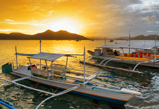 Traditional boats at sunset. Philippines Royalty Free Stock Image