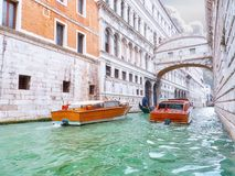 Traditional boats taxi passing over Bridge of Sighs in Venice Royalty Free Stock Photo