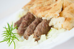Traditional bosnian food cevapi with flat bread and onion Stock Photography