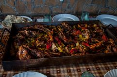 Traditional Bosnian meal. Served on the table, meat with vegetables in the aluminum dish Stock Photos