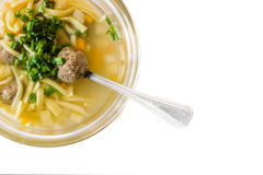 Traditional bouillon. Tasty bouillon with liver dumplings on the white background Royalty Free Stock Image