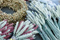 Traditional bouquets of ripe cereal wheat, linen, field grass. Vintage harvest background, copy space. royalty free stock photo