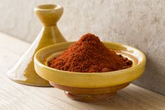 Traditional bowl with Moroccan dried ground paprika. Traditional yellow bowl with Moroccan dried ground paprika Royalty Free Stock Photos
