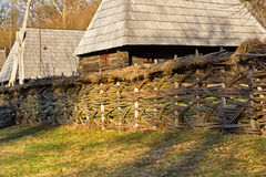 Traditional braiding twigs fence in romanian village Royalty Free Stock Photos