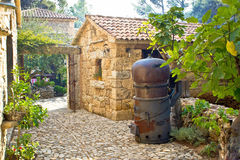 Traditional brandy still in stone village Stock Photo