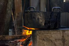 Traditional Brazilian food being prepared on old and popular wood stove stock photos