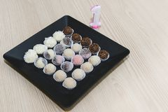 Traditional brazilian sweets - brigadeiros - over wood background. stock image