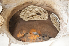 Traditional bread. Baking traditional bread in oven in iran Royalty Free Stock Images