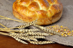 Traditional bread and cereals. Delicious home made bread set on jute sack with dry wheat ears and wheat and cereals Stock Photo