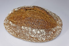 Traditional bread. Fresh loaf of bread. The recipe with wheat flour, water, rye flour, sunflower seeds, yeast, flaxseed, oats, malt flour, sesame oil, salt Royalty Free Stock Photos