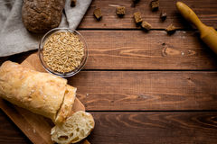 Traditional bread with rolling-pin wooden table background top view space for text Stock Image