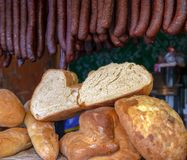 Traditional bread and sausages made in house. Romania, arranged to be served and presented for sale at a traditional fair foods Royalty Free Stock Image