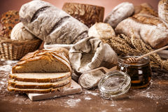Traditional bread set on wooden table Royalty Free Stock Images