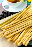Traditional bread sticks on plate Stock Photography