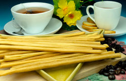 Traditional bread sticks on plate and cup of tea. Soft light Stock Photography