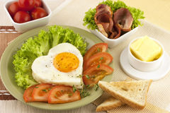 Traditional breakfast with bacon , fried eggs and toast Stock Image