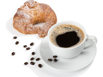 Traditional breakfast with coffee and croissant. White cup of coffee and croissant isolated on white background Royalty Free Stock Images