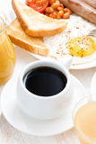 Traditional breakfast - coffee, juice, eggs and toast Stock Image